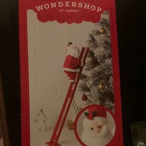 New in box animated climbing Santa